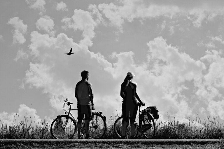 man, woman, bicycle ride